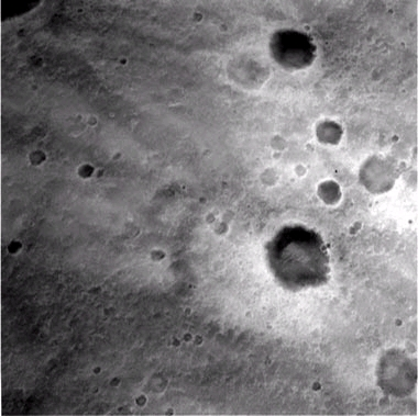 This image, taken by the Descent Image Motion Estimation System (DIMES) camera located on the bottom of Spirit's lander, shows a view of Gusev Crater as the lander descended toward Mars. The picture was taken at an altitude of 1,400 meters. These images helped the onboard software to minimize the lander's horizontal velocity before its bridal was cut, letting Spirit fall safely to the surface of Mars