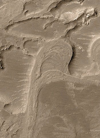 This pair of ridges may have been the floor of a meandering river on Mars.  NASA / JPL / MSSS  The loop at the center of the picture appears to be the inverted form of a former meandering stream that was cut off as the channel adjusted its course. The floor of this cut-off meander likely became a ridge because it was more resistent to erosion than surrounding land.  NASA / JPL / Malin Space Science Systems